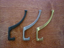 arts & crafts cast brass and iron coat hook suite